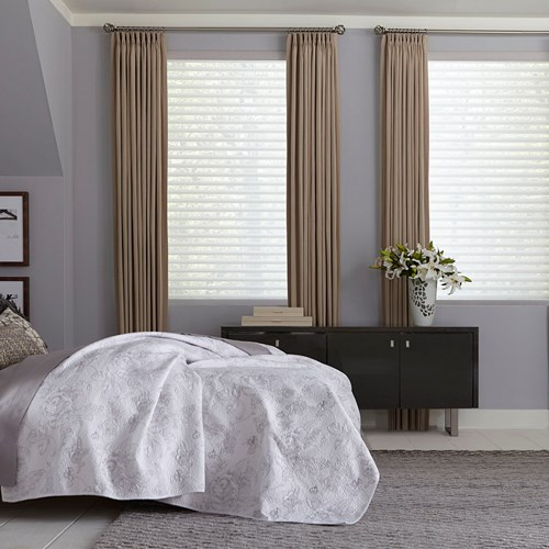 The light filtering sheer shade paired with the easy classic pleat drapery. Shade Color: Linen Ash S65BN823; Drapery Color: Linen Stripe Tan-Smoke
