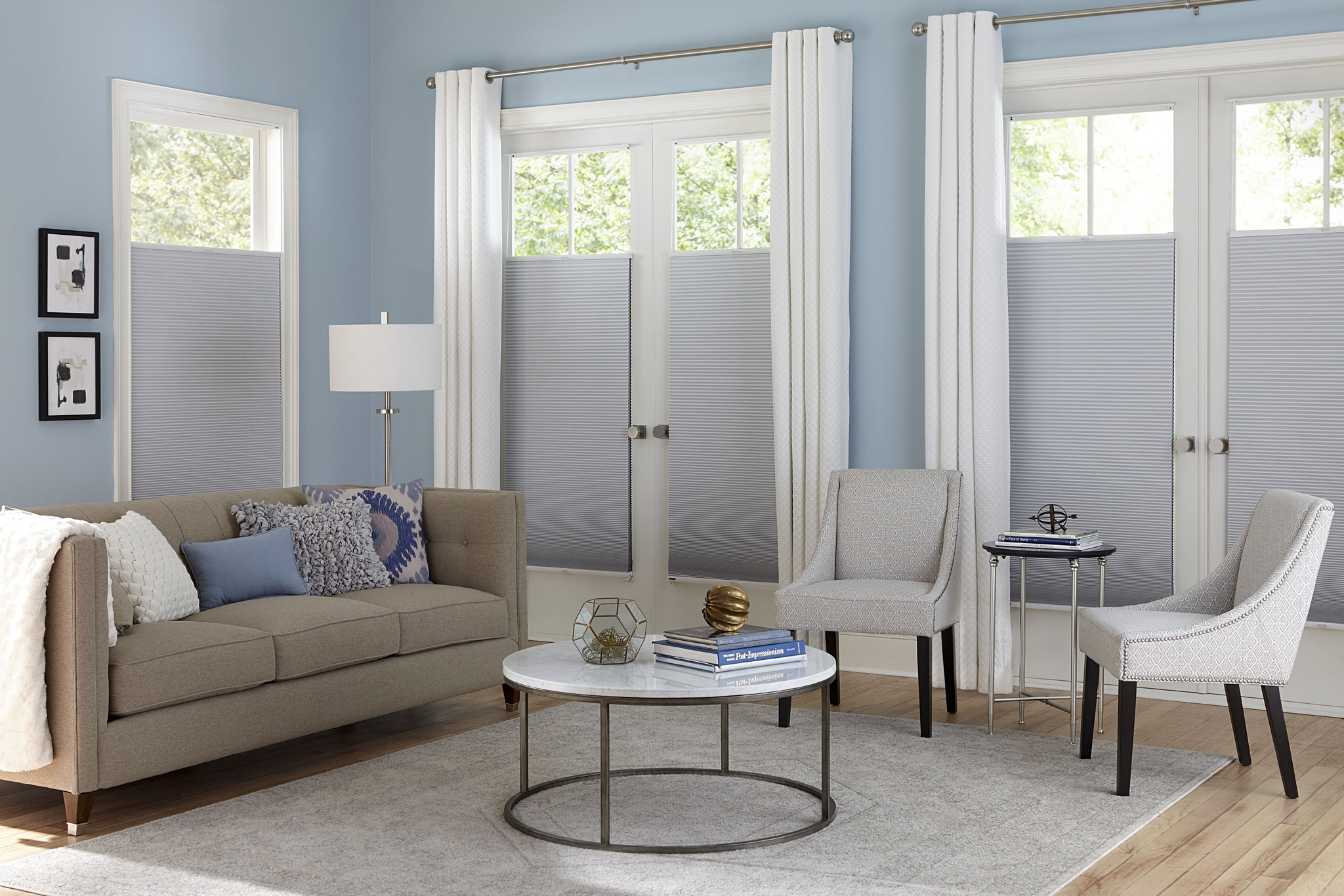 blackout cellular shade paired with the easy grommet drapery shade color glacier dc4001 drapery color riga ocean foam