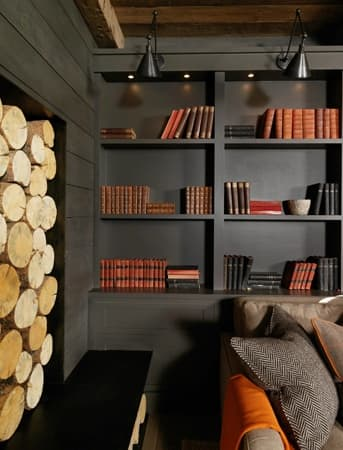 A stacked wood fireplace brings in a rustic feel