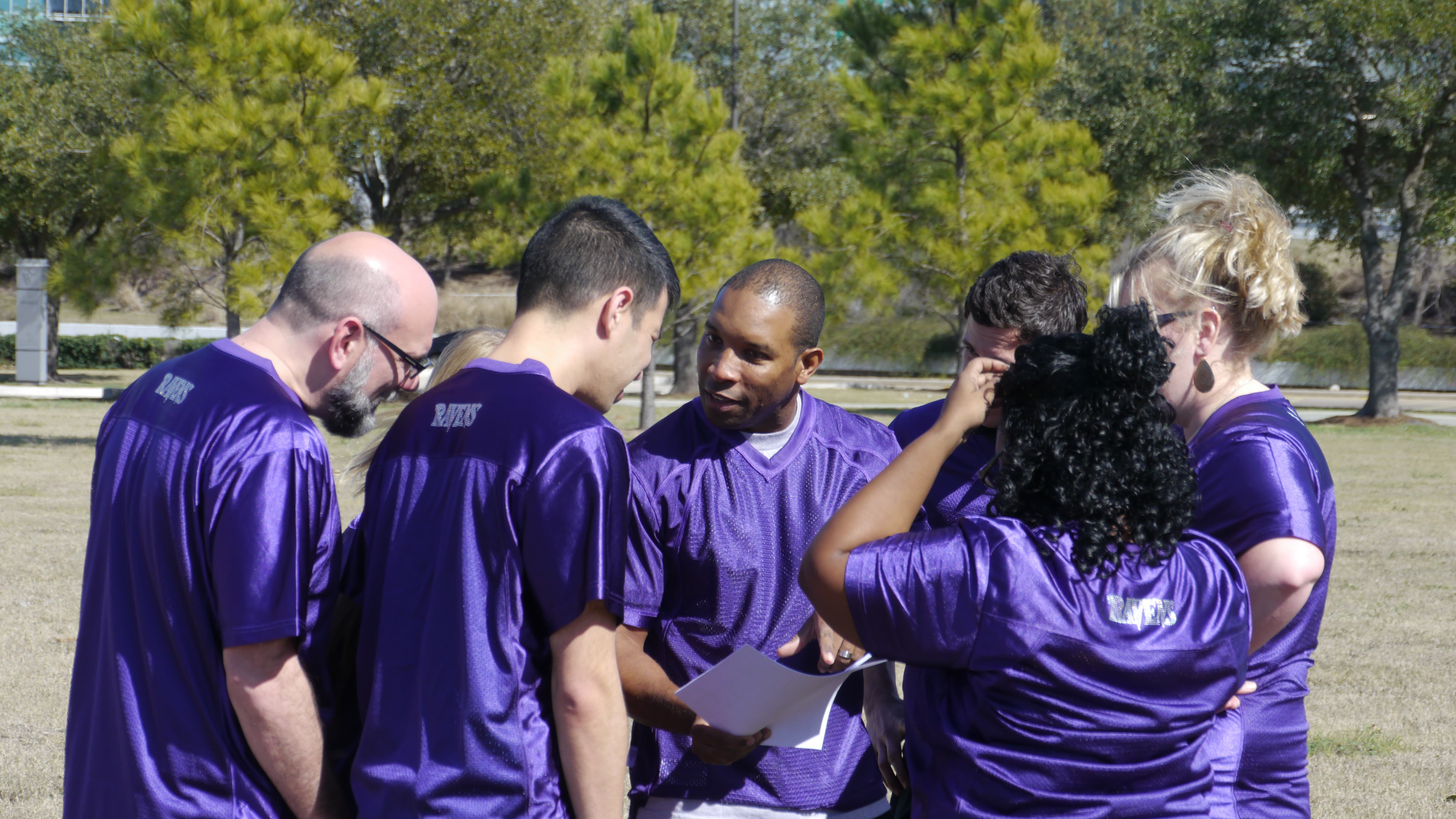 The Ravens gather round to study their plays.