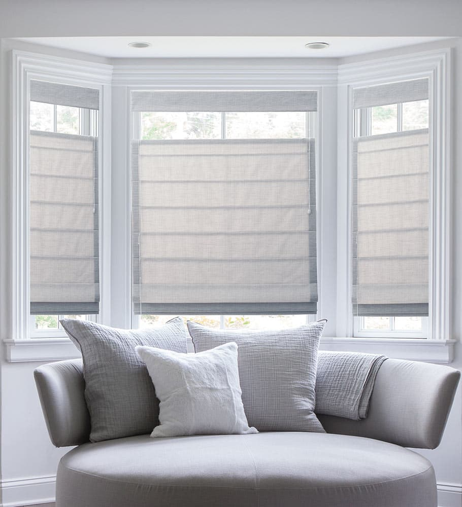 The ultimate guide to blinds for bay windows the for Roman shades for bay windows
