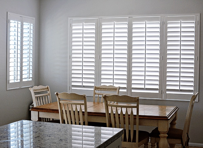 No more dark rooms signature plantation shutters brighten for Indoor wood shutters white