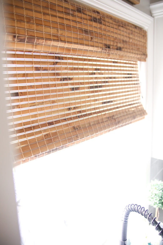 bamboo blinds in window over sink