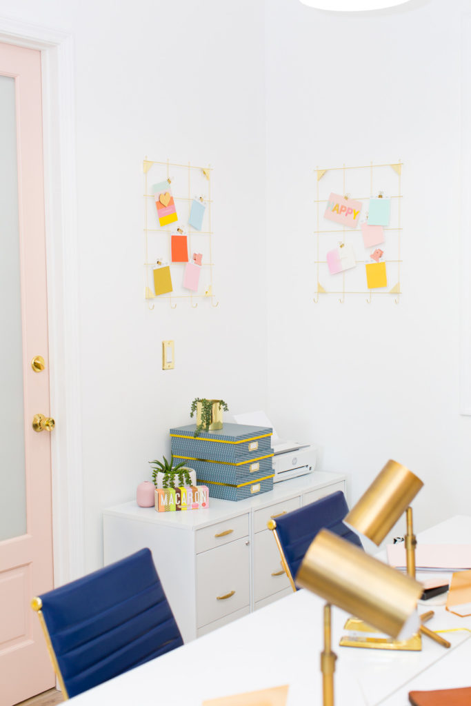 Office with gold desk chairs, white walls and gold clip memo boards